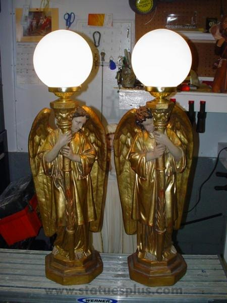 Angels, pair, with Lamps
